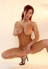 Busty Redhead Gets Naked